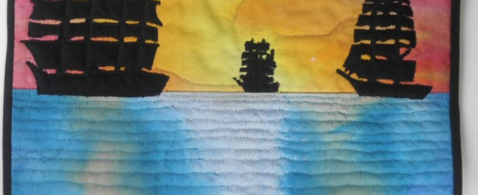 quilt with pirate ships sailing into the sunset