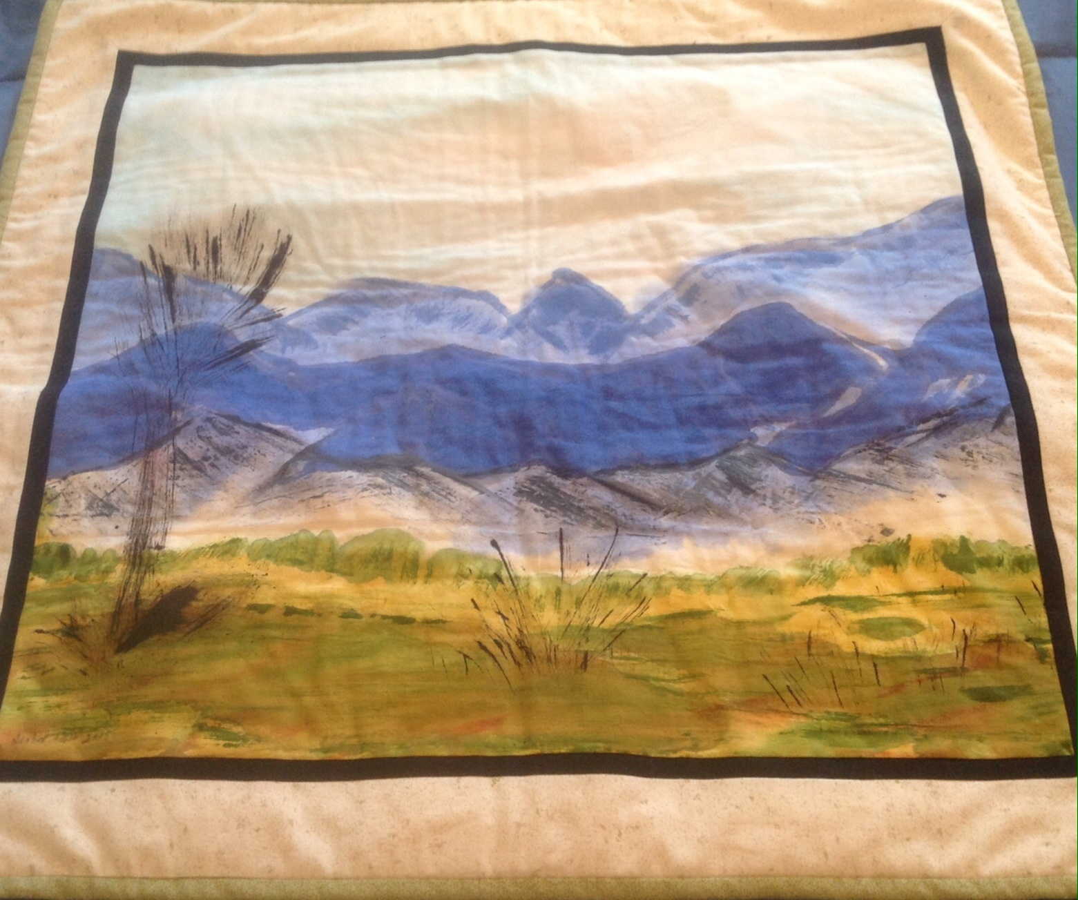 To use hand painted landscape fabric as quilt wall art