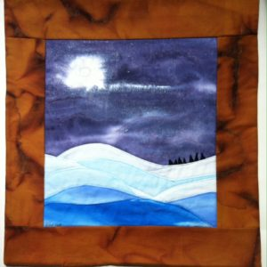 winter landscape quilt with snow and moon