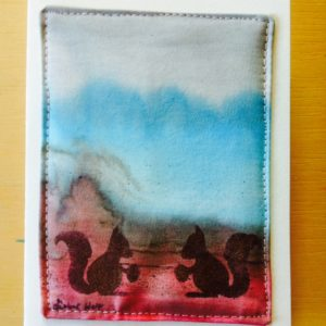 postcard mini quilt with hand stenciled squirrels